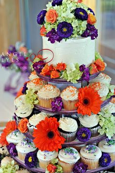 i normally dont like cupcake towers but this one actually is pretty and looks like a cake