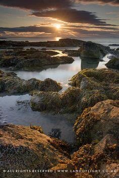 Setting sun viewed from Lossiemouth Beach, Moray, Scotland.