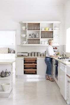 contemporary white kitchen - <3 basket drawers and plate rack!