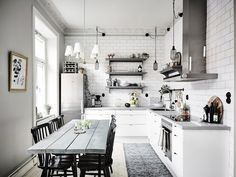 Clever idea to run the metro tiles right up to the ceiling instead of just a strip above the worktop