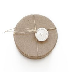 Make a faux wax seal out of air dry clay + rubberstamp.  paint these any color!