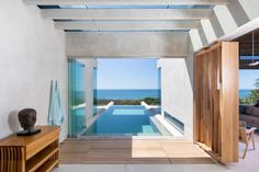 At the heart of the ground floor is a slender swimming pool that gestures toward the sea, cantilevering over the hillside. Natural Swimming Pools, Swimming Pool Designs, Architecture Office, Ground Floor, Costa Rica, Lush, Terrace, Studio, Outdoor Decor