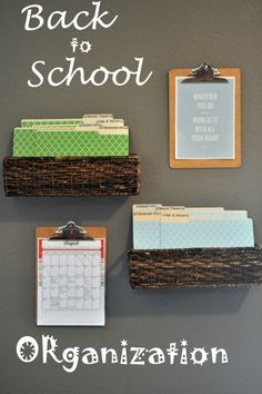 rectangular baskets on wall with file folders/dividers, clipboards