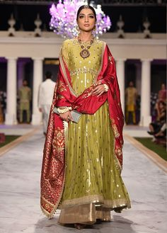 A classic anarkali silhouette in a hand woven tile jacquard fabric. The piece is extensively hand crafted with gota and zardoze on the panels, sleeves [. Shadi Dresses, Indian Dresses, Indian Outfits, Latest Wedding Dresses Indian, Mehendi Outfits, Designer Suits For Wedding, Indian Designer Suits, Pakistani Wedding Outfits, Pakistani Bridal Dresses