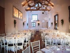 Guests can sit down to the Wedding Breakfast within a pretty, rustic setting at Merriscourt. #weddingvenues #rusticwedding #cotswoldwedding