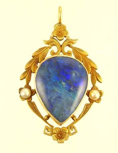 Art Nouveau opal and pearl pendant French? Circa 1900 Lovely black opal accented by natural pearls set in 14K gold.