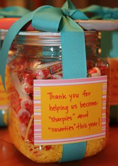 """""""Thank you for helping us become sharpies and smarties this year!"""" The jars came from Michael's (plastic sorting jars in the scrapbook section, 3/pack) and then I just filled them up with smarties candy and tied on some fun-colored Sharpies. Okay, so you can learn from my panic-stricken moment late one night...Target does not sell smarties. Walmart does not sell smarties. At least not ours."""