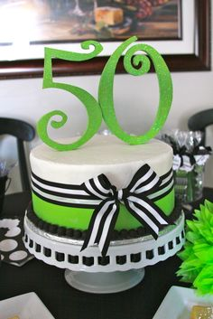 Cake at a 50th Birthday #50thbirthday #cake Minus the bow for a gentleman... but am loving the colors