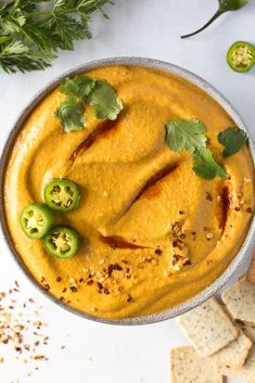 Vegan queso made with steamed carrots, cashews, and plenty of nutritional yeast. Gluten-free, grain-free, and oil-free. Serve it with tacos, taco salads, burrito bowls, chips, and vegetables!   Dressing, Dips, and Spreads   Flora & Vino Vegan Queso, Vegan Recipes, Vegan Meals, Dip Recipes, Taco Salads, Cooked Carrots, Raw Cashews, Unsweetened Almond Milk, Nutritional Yeast
