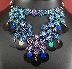 A sequin and chain maille necklace.