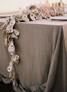 oyster shell garland, table decor - good idea for shells from sailing trips