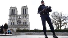 March 27, 2016: A French Police officer stands guards as worshipers arrive for the Easter mass at Notre Dame Cathedral, in Paris.