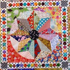 Scrappy windmills quilt.  Look at the hexagons in the sashing!