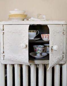 My dream home has one of these~  Billy Reid cabinet,biscuit warmer radiator....
