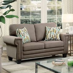 Sanders Loveseat - CM6285GY-LV $316  Description :  Arrange a cozy yet structured living setting with this seating collection. Available in two color options, this sofa set showcases fitted cushion designs that emanate a modest atmosphere. Nailhead trim accentuates the linear arms and lifted height.  Features :  Transitional Style High Density Foam Cushions Nailhead Trim Includes Accent Pillows Linen-like Fabric Available in 2 Colors Squared Track Arms Warm Gray Dimensions :  L