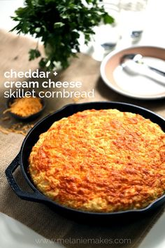 "This Cheddar and Cream Cheese Skillet Cornbread will have you reaching for just ""one more piece"" again and again. Butter, cheddar and cream cheese are swirled together within the batter before being poured into a piping hot iron skillet. The result? A mile high hearty cornbread that is perfect warm from the oven, at room temperature and at any time of day."