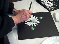 An easy video on painting daisies