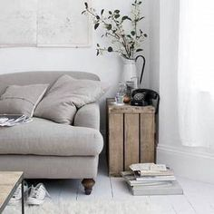All about these neutrals. From the light grey couch to the wooden crate side table, this space is the epitome of a natural living environment. There's even a blossoming plant. Living Etc, Home And Living, Living Spaces, Style At Home, Wabi Sabi, Living Room Designs, Living Room Decor, Bedroom Decor, Crate Side Table