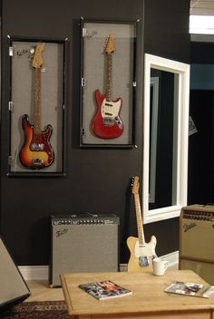 wall mount guitar display cases... like that they look like the front of a Fender amp