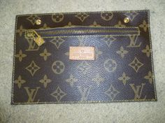 """Look at the photo -- does this look like authentic LV to you?  Mendacious Etsy seller claims she bought this at a """"vintage shop"""" and doesn't know its """"history"""".  Believe that whopper of an Etsystory, or not."""
