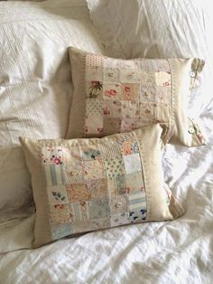 She has combined linen with beautiful faded vintage fabrics. via The Hen House -- This looks like a quilt piecing project I could actually do.vintage/pastel blocks sewn into pillows. HenHouse: Spring has SprungFarm House Blessings~Old Fashion Vintage Patchwork Cushion, Quilted Pillow, Quilting Projects, Sewing Projects, Sewing Pillows, Lace Pillows, Linens And Lace, Vintage Fabrics, Vintage Prints