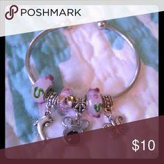 Disney charm bracelet. Free earrings included. Beautiful Disney charm bracelet with pink beads. Brand new. FREE earrings included with your purchase. FAST shipping! Disney Jewelry Bracelets