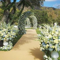 Blue and cream dream path down the wedding aisle by Jeff Leatham