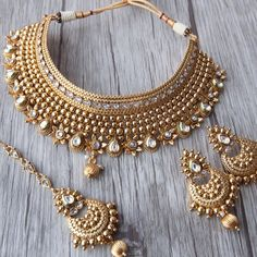 Getting married or attending a wedding? Check out this Dazzling Choker set decked in beautiful Kundan stones, statement worthy and classic ! Indian Bridal Jewelry Sets, Bridal Jewellery, Handmade Jewellery, Pakistani Jewelry, Bollywood Jewelry, Gold Jewelry Simple, Silver Jewelry, Long Chain Necklace, Gold Necklace