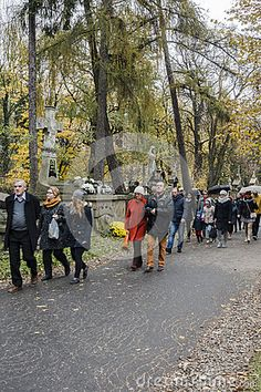 People in the Rakowicki Cemetery, one of the best known cemeteries of Poland, located in the centre of Krakow, Poland. First November.