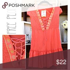 "TIE-FRONT Embroidered Tunic with Flounce Peplum Throw this easy tunic on for a summer day out, or use as a beach cover up. Stretch fabric and tie-up front make this more variable in size.  The tunic length makes this versatile- wear as a little cover up, pair with short-shorts for a cute-but-sexy look, or wear with jeans for a laid-back look. No flaws noted. Tagged size xs, would easily fit s maybe m. Measurements: Bust 14"", Approx. waist 12+"",  loose hip. Approx 2="" stretch. 100% viscose…"