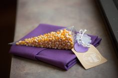 wedding favor, popcorn :) cute idea since we met working at the movie theatre :)