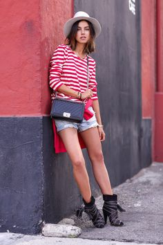 striped top with denim shorts and edgy boots