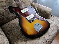 1959 Fender Jazzmaster. Sunburst finish with red tortoise shell pickguard... and a delicious amber top on the pickup selector.