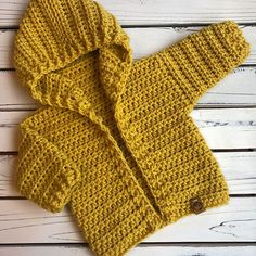 Rose black rose stitches on this painted canyon cardigan just screams fall! golden yellow is perfect for boys and girls i imagine it being worn for fall photos with a baby kimono free pattern Crochet Baby Sweater Pattern, Crochet Baby Sweaters, Baby Sweater Patterns, Knitted Baby Clothes, Baby Girl Crochet, Crochet For Boys, Newborn Crochet, Baby Knitting Patterns, Baby Patterns
