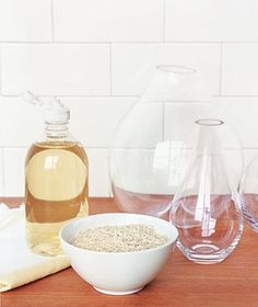 Real Simple's how to clean decanters and vases:  Fill the vessel halfway with warm water, add a few drops of dishwashing soap, two tablespoons of white vinegar, and one cup of uncooked rice. Swirl the mixture around for a couple of minutes (the rice will scrub the sides of the vase for you), then rinse and air dry.