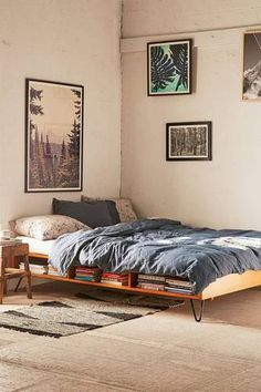 A Mid-Century Modern-inspired bed that doubles as a storage space or bookshelf // Urban Outfitters