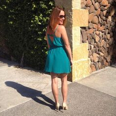 The vibrant teal Capri dress from Social Butterfly House was worn by the talented Los Angeles director and producer Shawn Ashley at a vineyard wedding in Napa Valley, CA. The flowy triangle bodice falls from adjustable spaghetti straps above a full skater skirt that cascades from an elasticized waist. It features horizontal straps above a sexy low V back cutout. The dress is fully lined with a center back zipper.
