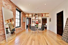 Nice blend of brick, wooden floors, plaster work on walls on ceilings and wooden shelving.