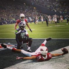 Michael Floyd of the Arizona Cardinals scores a touchdown against the Seattle Seahawks.