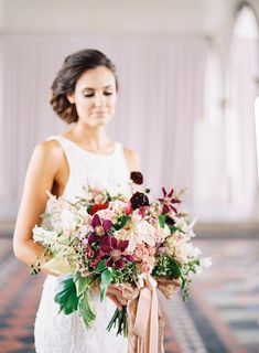 Photography: Marissa Lambert Photography - undefined Floral Design: Kim Starr Wise - undefined Wedding Dress: Blanc Bridal Couture - undefined   Read More on SMP: /2015/11/01/organic-red-new-orleans-wedding-inspiration/