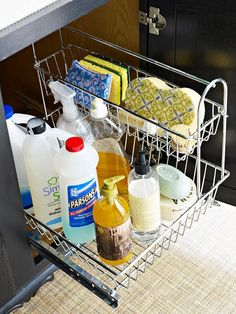 Make the most of the sliver of space beside a drain pipe with a narrow two-tier basket. This model features a top bin that lifts off and a bottom bin that pulls out for easy access. The portable caddy is perfect for holding kitchen cleaning supplies. To protect the cabinet from leaks or spills, line the base with a waterproof mat.