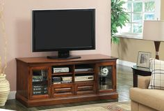 TV Stand CM5052-TVALAMANORBeautifully finished in antique oak, this transitional media console has multiple drawers and shelves for maximum storage and display space. The cabinets have framed glass doors and the drawers have twisted rope design knobs.Transitional StyleFramed Glass DoorsDrawers