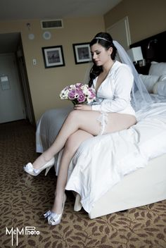 bride on the bed getting ready. unique wedding picture