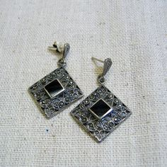 These elegant Victorian styled vintage sterling silver and marcasite pierced earrings feature a very intricate design in sterling silver, They are post