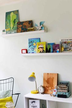 Display their favorite book of the moment on a minimalist shelf.