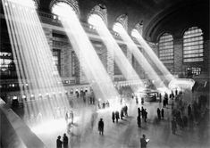 Sunlight floods in through windows in the vaulted main room of New York City's Grand Central Terminal, illuminating the main concourse, ticket windows and information kiosk. Photo taken ca. 1935-1941. (Courtesy NYC Municipal Archives)