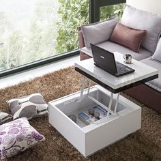 This stylish lift-top coffee table is an ideal addition to any room in need of some space-saving furniture. This contemporary coffee table features a sleek high-gloss black-and-white finish that will complement the decor of any modern home. Space Saving Furniture, Furniture For You, Furniture Design, Smart Furniture, Furniture For Small Spaces, Office Furniture, Lift Up Coffee Table, Coffee Table With Storage, Coffee Tables