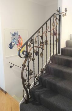 Jalmer can create a decorative balustrade to make a feature of your entry area.  This one features a grape vine, with sculptured branches and a blue wren on top.  We can make beautiful ironwork to suit any theme or budget, so let out your creativity!