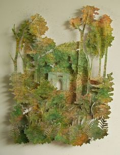 Through the trees to Fisher's Hall - Rosie Scott-Massie. Pinned papercut maps