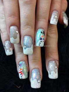 Freehand christmas nail art with snowmen and swarovski crystals